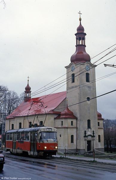 Liberec 42 passes the Holy Trinity Church at Vratislovice on 19th April 1993.