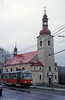 Liberec 42 passes the Holy Trinity Church at Vratislovice on 19th April 1993.