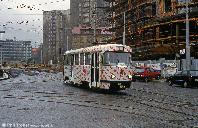 Car 55 amongst signs of post communist rejuvenation in the centre of Liberec on 19th April 1993.