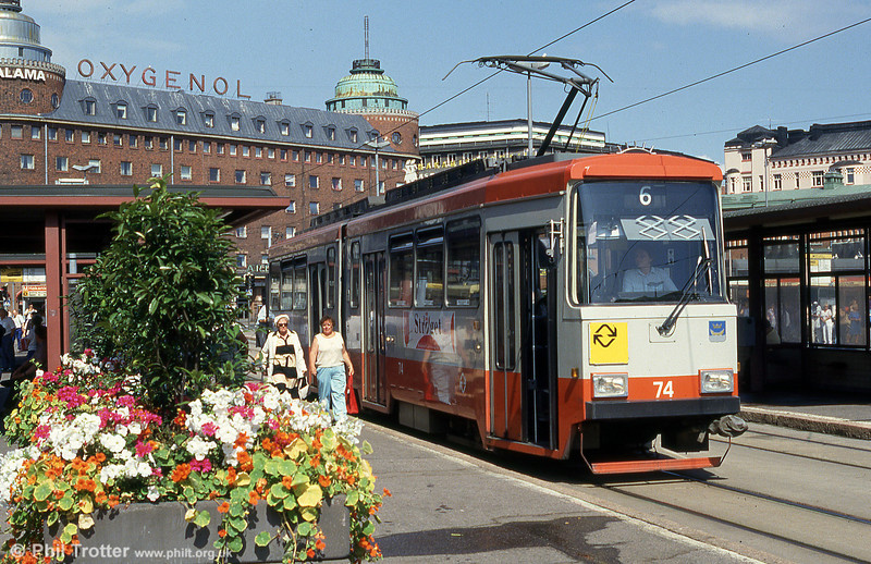 Helsinki car 74 in orange and grey livery at Hakaniemi on 1st August 1991. The Valmet NrI and NrII class trams were originally painted in an orange and grey livery, but it proved unpopular and both classes were later repainted in the traditional yellow and green.