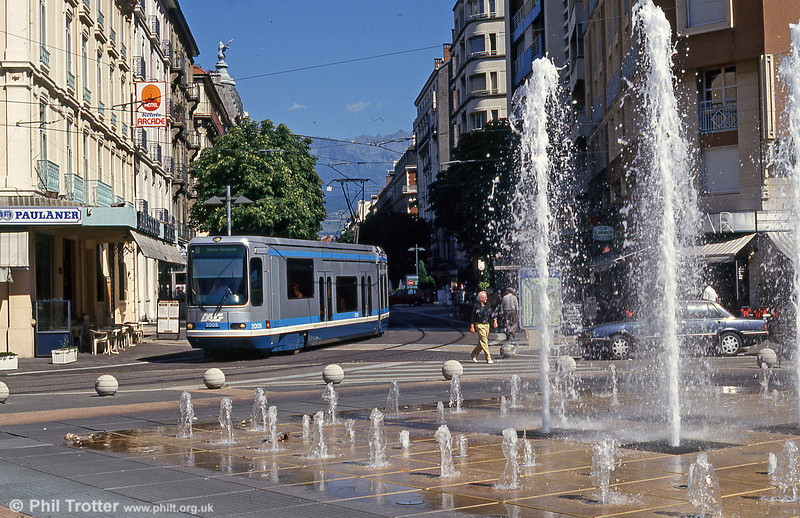 On 28th July 1993, Grenoble 2005 passes the fountain near Gares Europoles. The attention which was given to improving street furniture as part of the tramway implementation is clear from these photographs.