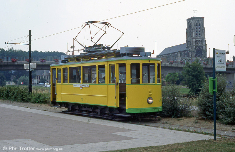 Neuchatel car 74 of 1921 with the backdrop of Saint-Vaast church in Wambrechies in August 1995.