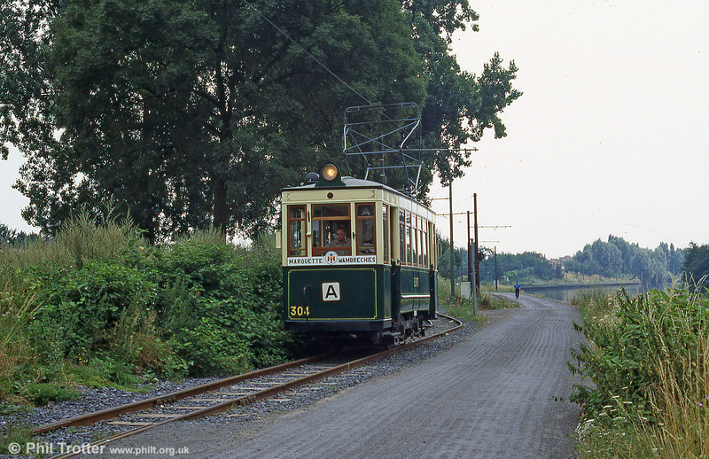 Lille (ELRT/SNELRT) car 304 of 1906 makes a convincing recreation of a roadside rural tramway in August 1995.