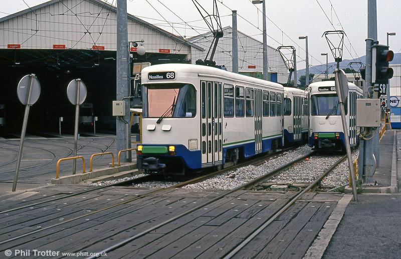 PCC cars pass St. Pierre depot on 1st September 1989.  The depot has since been demolished and the area is now used to park buses; a new depot has been constructed behind the old one.