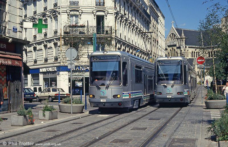 Paris line T1 cars 110 and 117 in Rue Auguste Delaune, Saint-Denis on 5th August 1993.