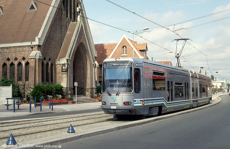 Paris line T1 ( St. Denis - Bobigny) opened in December 1992 using Alsthom cars based on those at Grenoble. Here, car 101 passes La Corneuve on 5th August 1993.
