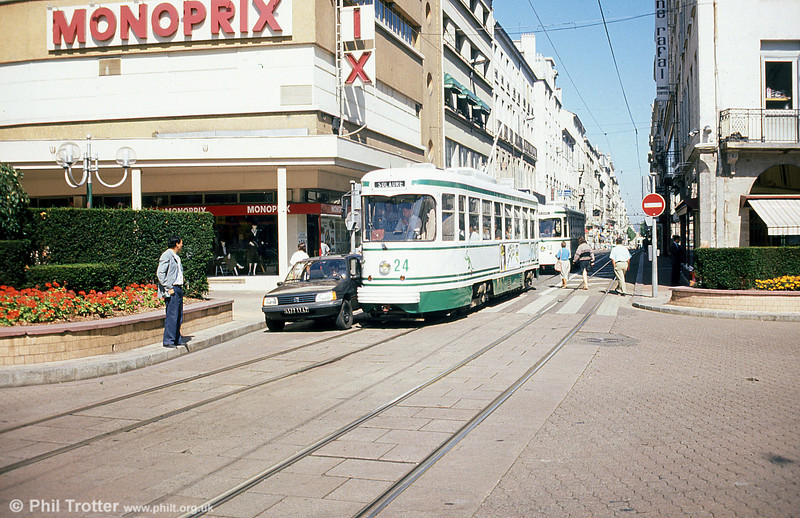 Tram Pinch! 524 and an unwary motorist at Peuple on 31st August 1989.