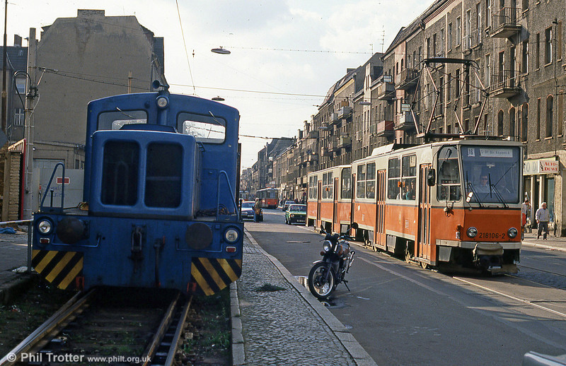 An industrial loco is passed by Tatra T6A2 tram 106 in Wilhelminenhofstrasse, Berlin on 9th April, 1991.
