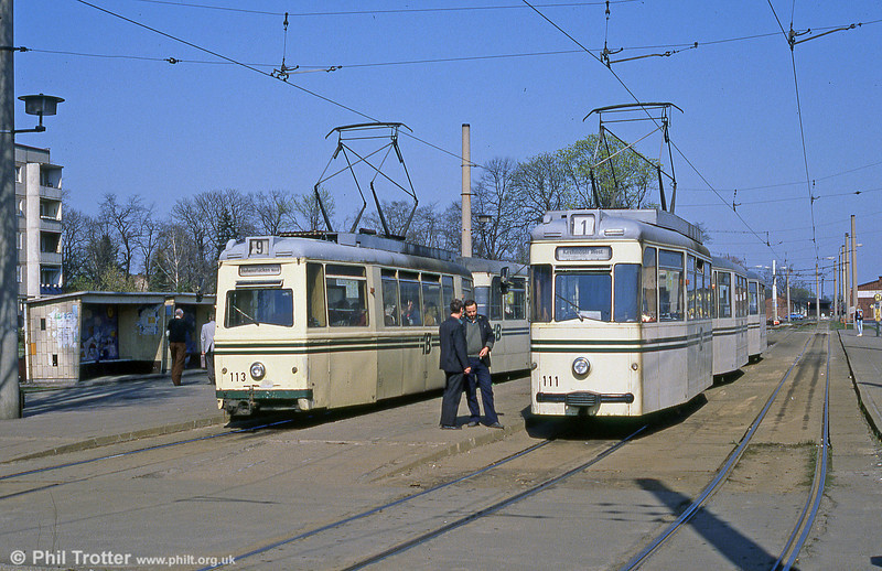 The drivers of Lowa car 113 and Gotha car 111 in discussion at the Hauptbahnhof terminus.