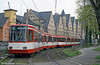 Koln interurban car 2211 and some severe Germanic architecture at Ubierring on 17th April 1994.
