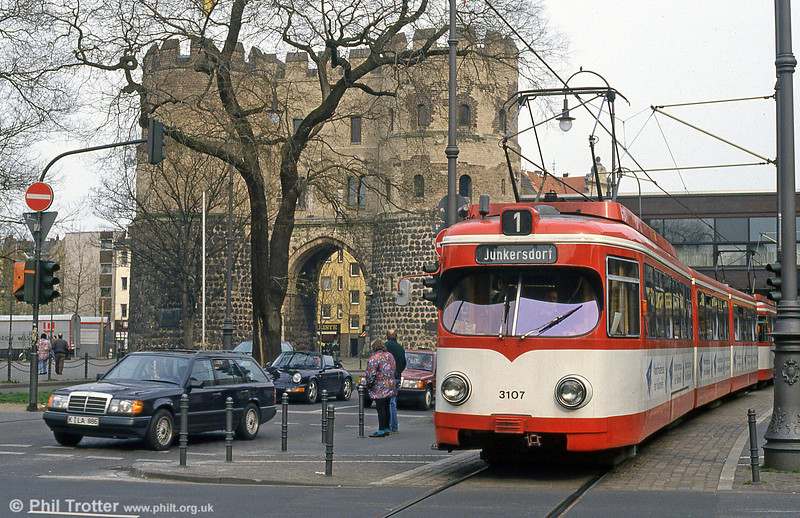 Duewag car 3107 alongside the Hahnentorburg, one of Cologne's three mediaeval gate houses, on 16th April 1994.