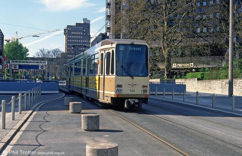 Dortmund Duewag car 144 of 1982 at Kampstrasse on 12th April 1991.