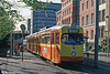 A second view of 1966-built Duisburg 1063 in orange and yellow livery in the spring sunshine at Konigstrasse.