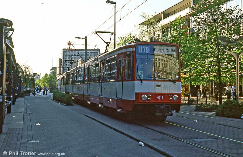Duisburg 4718, a Duewag B80C of 1985, arrives in Duisburg on interurban light rail line U79 from Dusseldorf.
