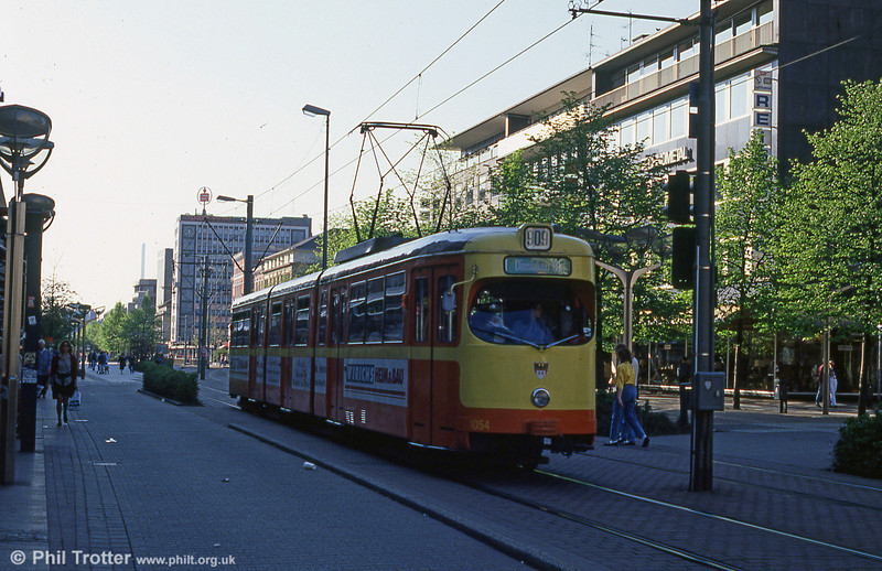 1965-built Duisburg 1054 in orange and yellow livery at Konigstrasse.