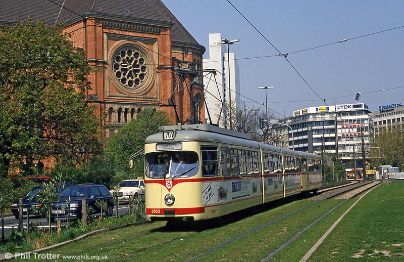 Dusseldorf 2663 passes Johanneskirche (St. John's Church - 1881) at Jan-Wellen Platz on 21st April 1994.