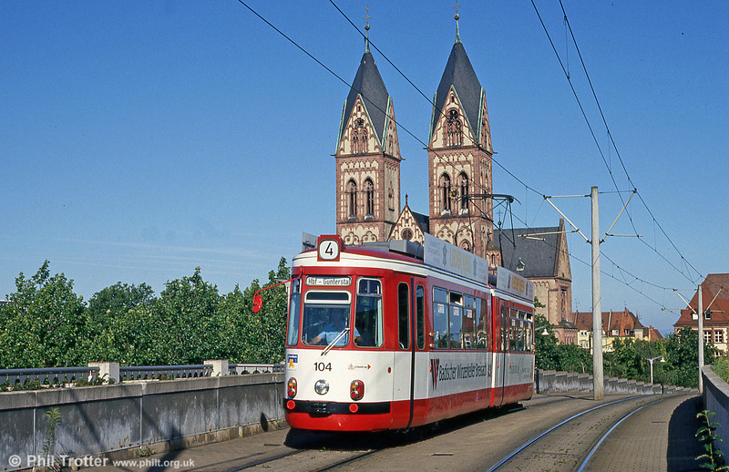 Freiburg im Breisgau 104, the first of the Esslingen GT4 cars of 1962, on the elevated section near the Hauptbahnhof on 1st August 1993.