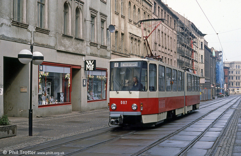Gorlitz 007, a Tatra KT4D at Berliner Strasse on 7th April 1991.This being early on a Sunday morning, the streets were almost deserted, but high frequency services were being operated! (Shades of the old DDR controlled economy.)