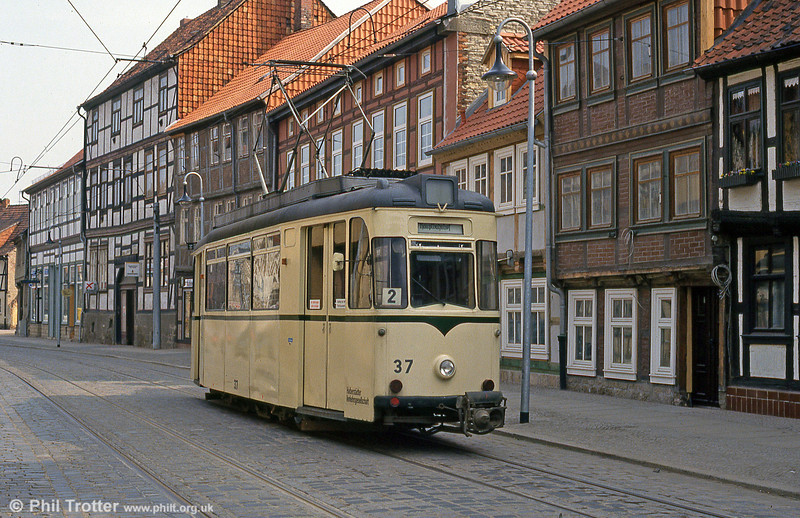 A traditional tram against a traditional backdrop! Halberstadt 37 of 1957 at Vogtei on 12th April 1993. 37 later moved on to Arad.