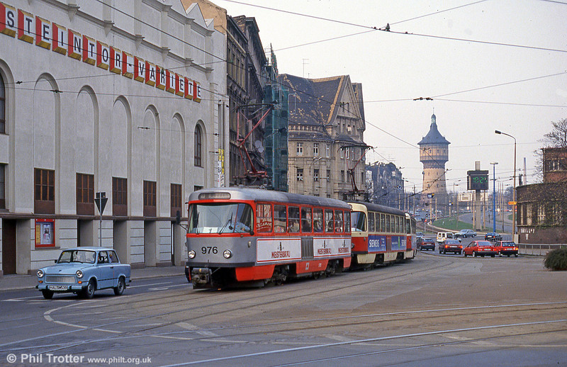 Tatra T4D 976 and a Trabi at Steintor on 13th April 1993. In the background is the Wasserturm Nord (Water Tower North), a 54 meter high water tower built in 1898 as part of the city's extension to the north.