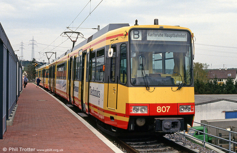 Karlsruhe is noted for the way in which it has merged its urban and suburban rail routes into one network, running trams along sections of the DB heavy rail system. This is new car 807 at Bretten on 22nd April 1993.