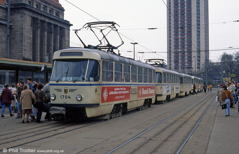 Leipzig's busiest stops are those outside the Hauptbahnhof. This is T4 1704 heading a line of cars on 5th April 1991.