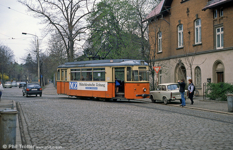 Naumburg car 32 dating from 1960 being held up by an inconsiderately parked Trabi at Michaelistrasse on 8th April 1991.