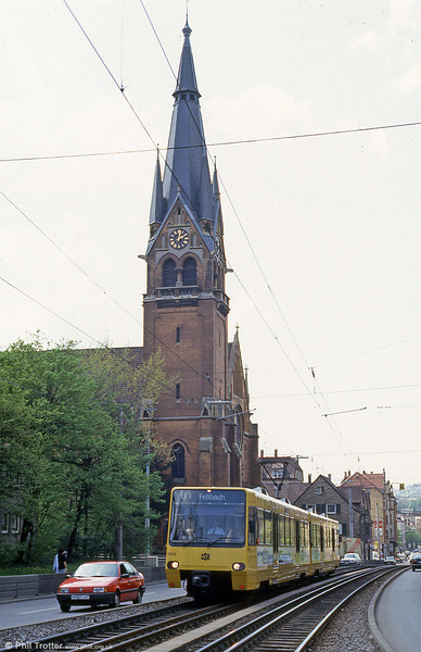 The Lutherkirche, Stuttgart forms a backdrop to 3033 at Kirchhof on 21st April 1993. Note the mixed gauge track.