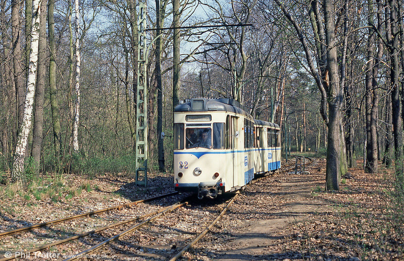 Something stirs in the woods: 1960 Gotha car 32 (ex-Dessau, 1978) approaches Rahnsdorf with its trailer on 10th April 1991.