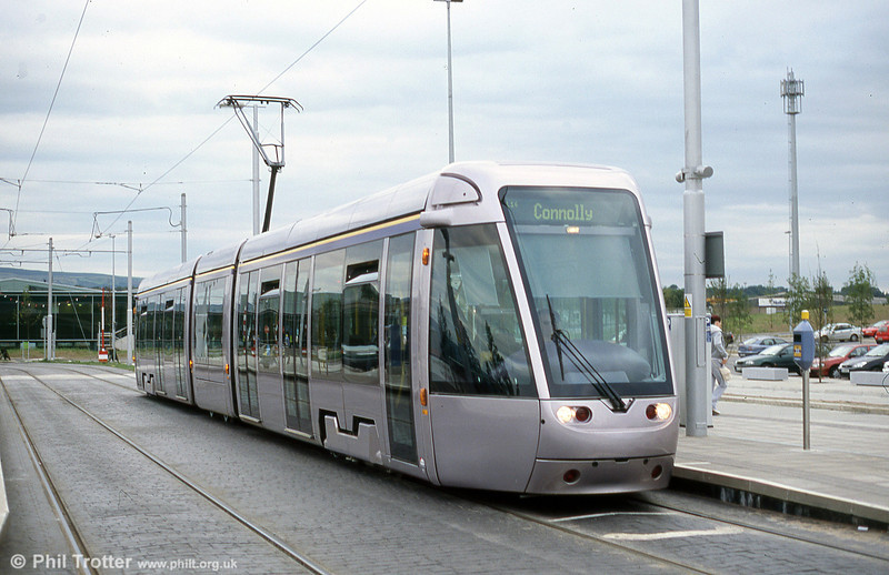 A Dublin Luas Alsthom Citadis 302 car pauses at Red Cow en route for Connolly Station on 10th August 2005. The depot for Line 1 can be seen in the background.