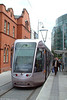 Dublin Luas Alsthom Citadis car 3025 at Busaras on 10th August 2005. The red brick building is the Coroner's Court.