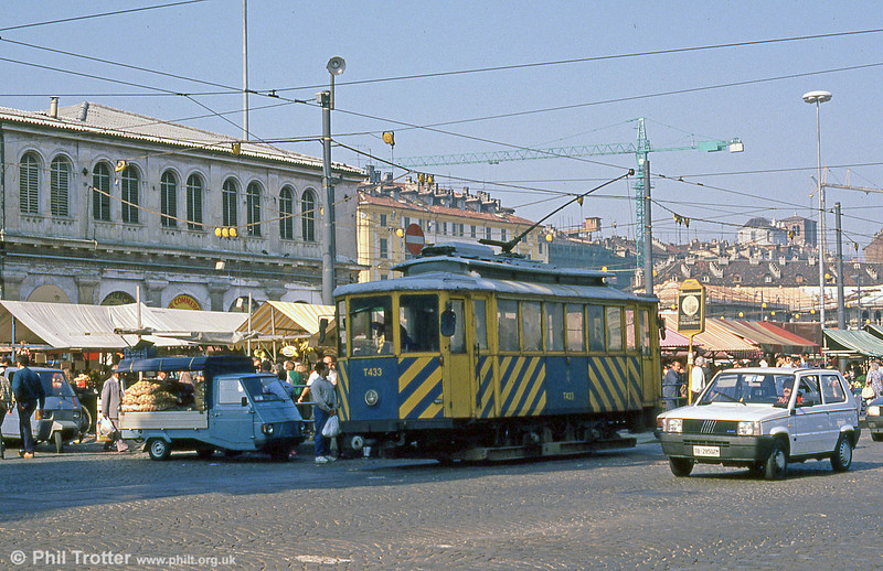 Torino works car T433 in the bustling market at Piazza della Republicca on 5th September 1989.