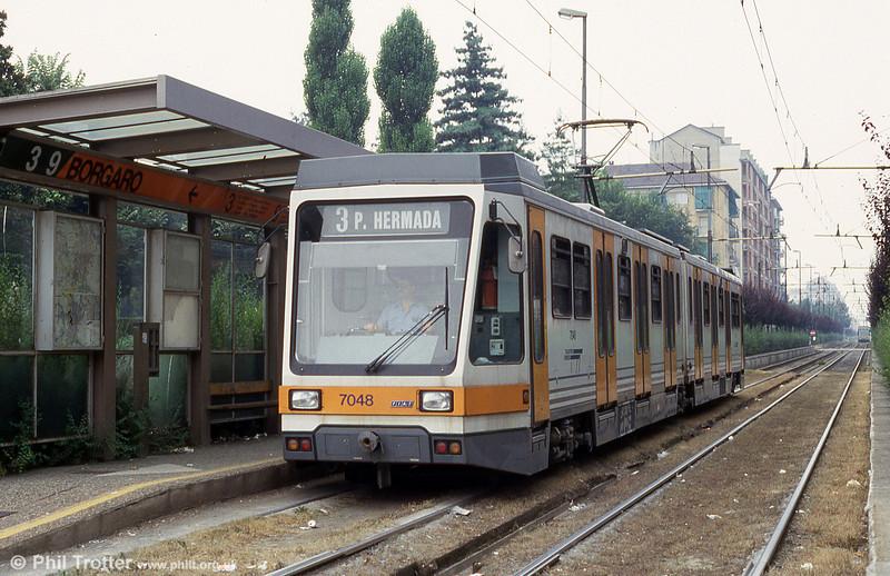Car 7048 at Borgaro on 30th July 1993.