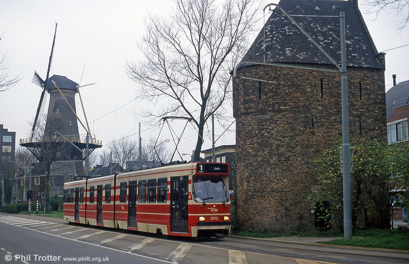 Windmills and the Netherlands are something of a cliche, but here's Den Haag 3013 with one as a backdrop at Delft on 15th April 1994.