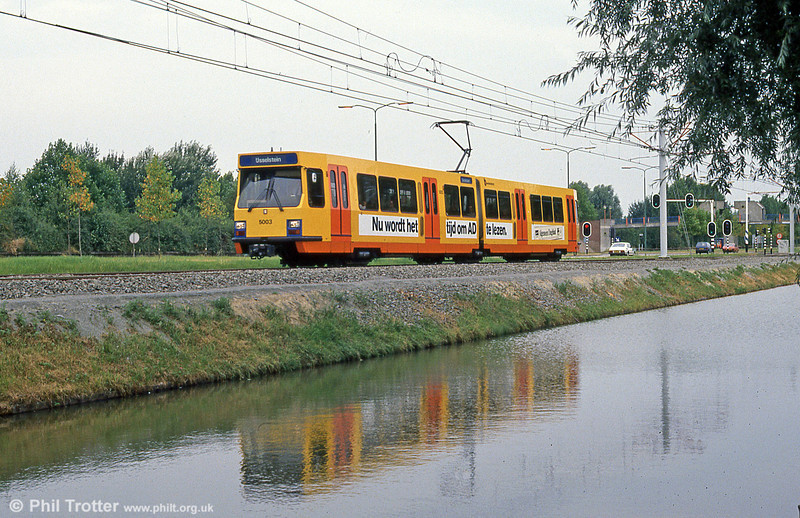 Car 5003 reflected in a canal at Wijkersloot on 8th August 1990.