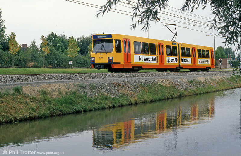 Utrecht 5016 reflected in a canal at Wijkersloot on 8th August 1990. (First published in Modern Tramway, 2/91).