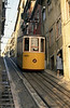 "The Bica funicular climbs the Rua da Bica for 245 metres from the Rua S. Paulo, near Santos, to the Calhariz district (Calçada do Combro/Rua do Loreto).<br /> The lower station of this funicular is almost hidden behind a façade on the Rua de S. Paulo with the inscription ""Ascensor da Bica"". It was constructed by Raoul Mesnier de Ponsard and opened to the public in 1892.In 2002 it was designated a National Monument. Car 1 is seen on 25th November 1993."