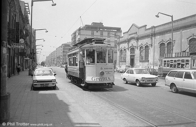 There are in fact three trams in this picture of Oporto 167 near Boavista terminus in Avenida do Boavista in June 1983. 167 dates from 1912.