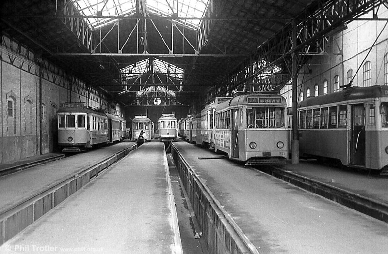 A view inside Santo Amaro depot, with a variety of cars awaiting service.