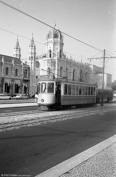 A Lisbon bogie car against the backdrop of Jeronimos Cathedral.