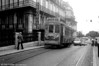 Lisbon 704, poorly disguised as a JCB, climbs away from Cais Do Sodre on circular route 25 or 26.