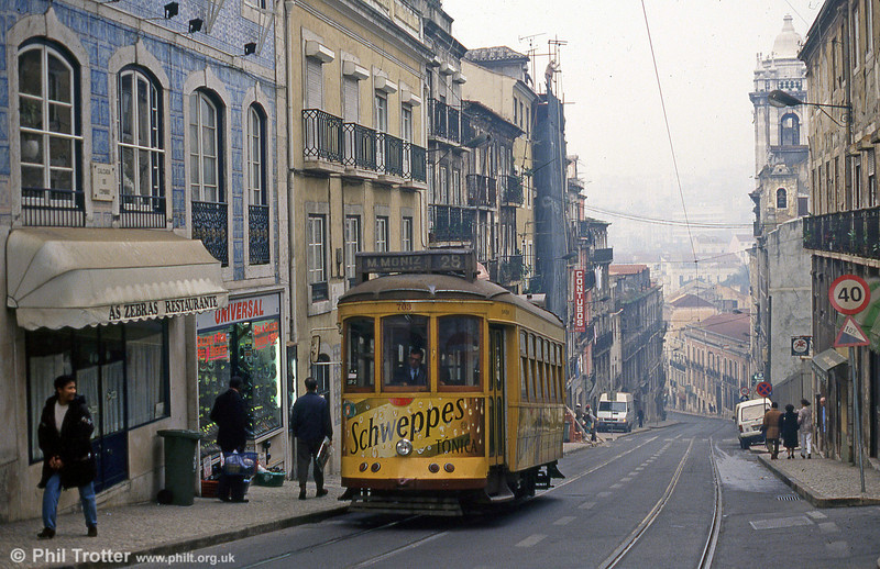 On a clear day, the view over Lisbon city from this point is spectacular. Car 703 climbs Calcada do Combro on 25th November 1993.