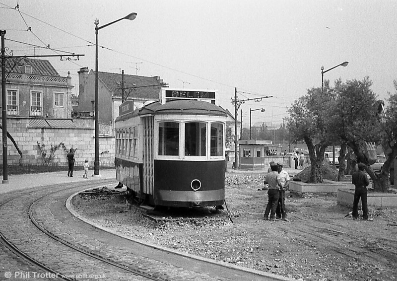Workmen stand around and chat, while former Libon car 269 serves as a Tourist Information Office at Belem.