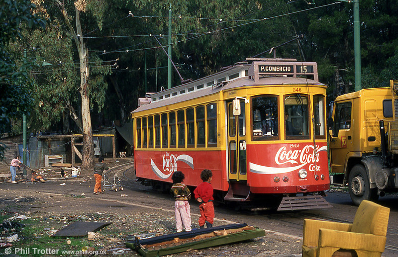 People living in makeshift houses, children playing in rubbish and stray dogs. This is Western Europe, 1993! Lisbon car 346 at Cruz Quebrada terminus on 23rd November 1993. The line used to extend through Jamor, a district of shanties.