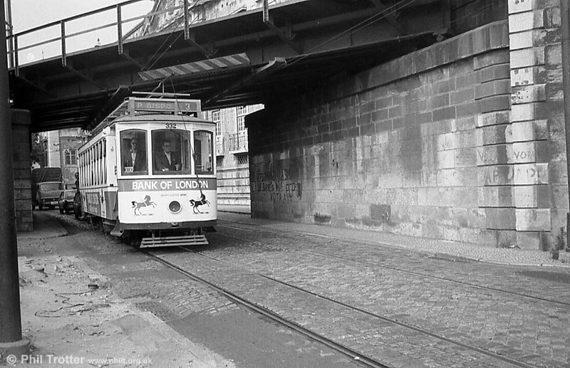 Lisbon car 332 passing under the railway bridge at Xabregas.