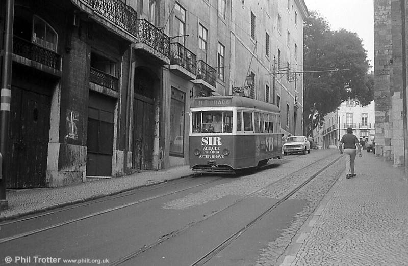 A male tram, perhaps...and an Austin Maxi.
