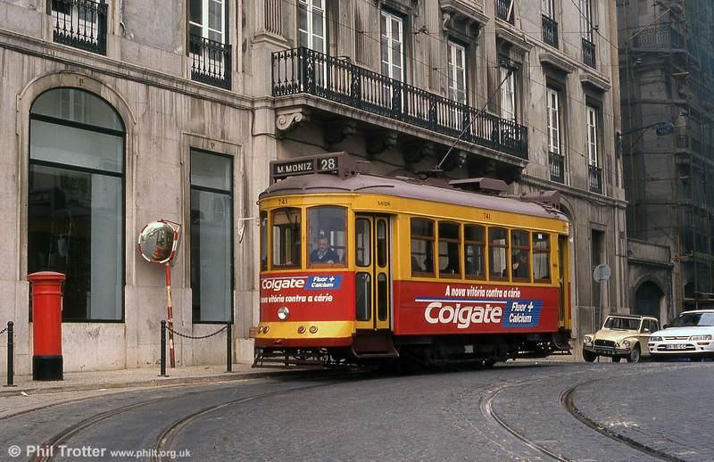 The Colgate advert and the red pillar box give this a British feel. Lisbon 741 on route 28, 27th November 1993. You don't see many Citroen Dyanes these days, either.