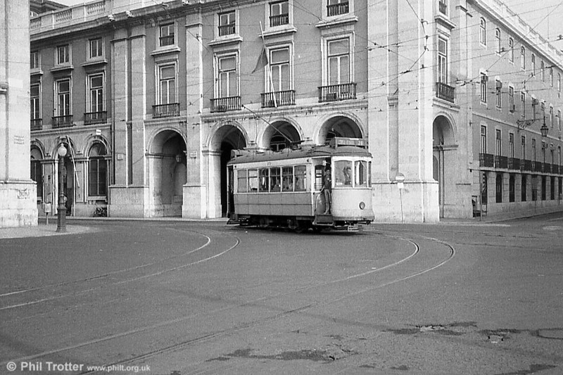 One of Lisbon's four wheel cars rolls into Praça do Comércio. Lisbon's tramway is built to the unusual 900mm gauge.