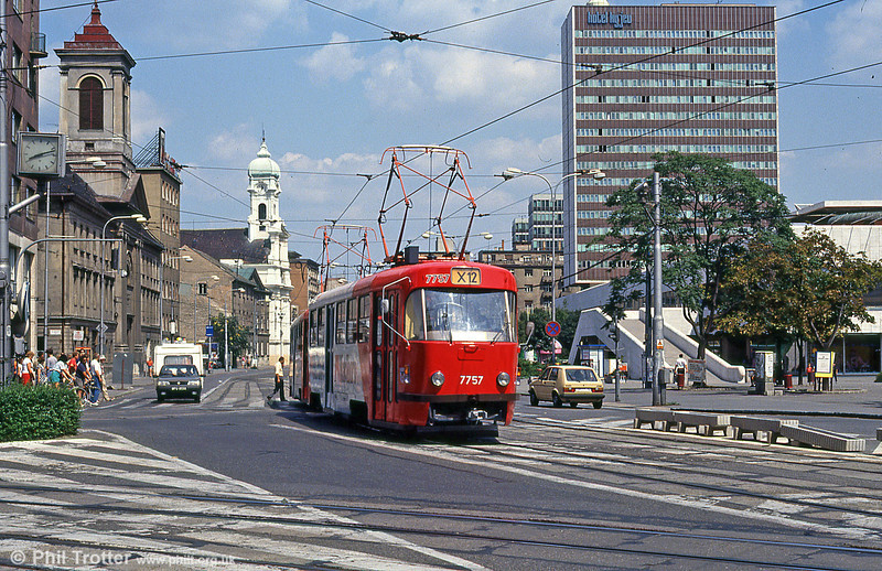 Bratislava Tatra T3 7757 at Kamenné námestie on 16th August 1992. The large building (right) is the Hotel Kyjev, built 1963 - 1973. Designed by architect Ivan Matusik, it is an example of severe communist architecture.