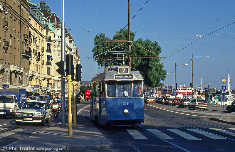Car 328 at Norrmalmstorg on 31st July 1991. And yes, that is a Routemaster behind -  it's RM354 (ex-WLT 354) in service with Star & Liten AB.